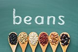 various beans on green chalkboard