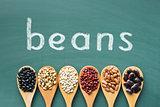 various beans on green chalkboard