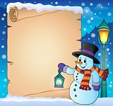 Parchment with snowman holding lantern