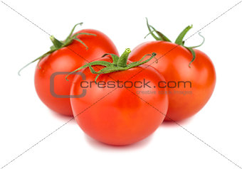 Three red ripe tomatoes