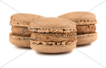 Three brown french macaroons