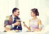 couple with main course and red wine at restaurant