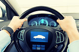 close up of man driving car with icon on computer