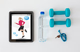 tablet pc, dumbbells, whistle and water bottle