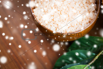 close up of himalayan pink salt in wooden bowl