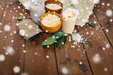 natural body scrub and candles on wood