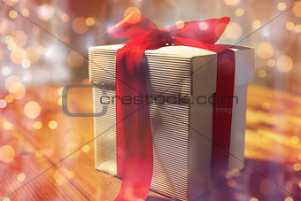 close up of christmas gift box on wooden table