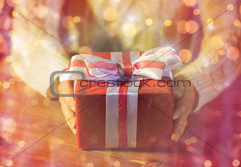 close up of woman with christmas gift