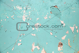 blue or turquoise wall with peeling paint surface