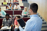 teacher with tablet pc and students at lecture