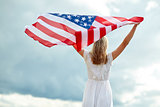 happy young woman with american flag outdoors