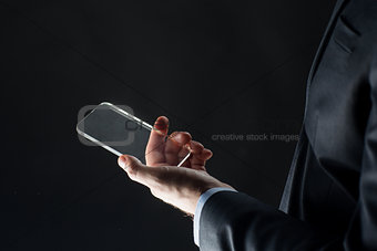 close up of businessman with glass smartphone