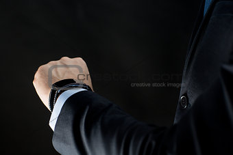 close up of businessman hand with smart watch