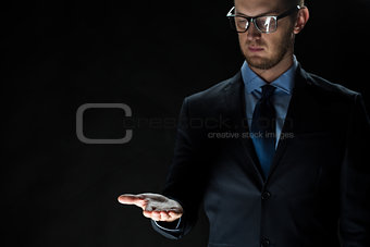 close up of businessman holding something on hand