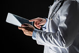 close up of doctor with tablet pc and stethoscope