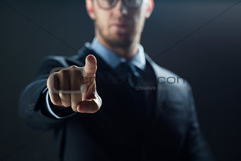 close up of businessman touching virtual screen