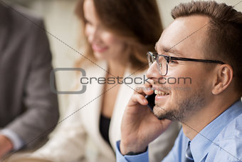 businessman calling on smartphone at office