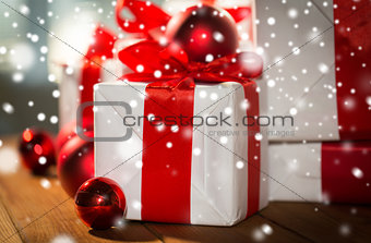 close up of gift boxes and red christmas balls