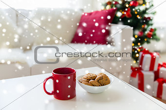 close up of christmas cookies and red cup on table