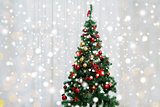 christmas tree in living room over window curtain
