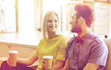 happy man and woman drinking coffee in office