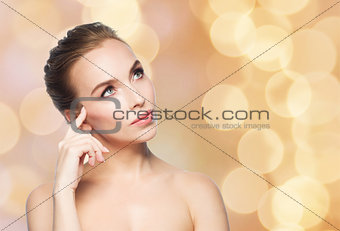 beautiful woman looking up over holidays lights