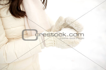 close up of woman with snowball in winter