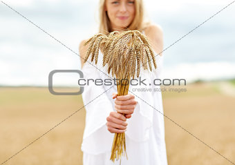 close up of happy woman with cereal spikelets