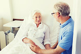 senior couple meeting at hospital ward