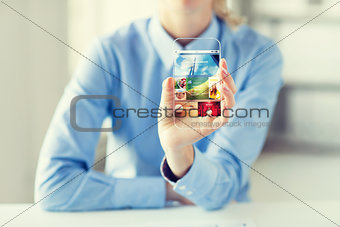 close up of woman with application on smartphone