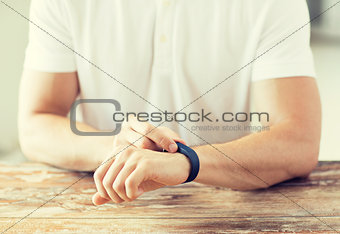 close up of man with heart-rate watch