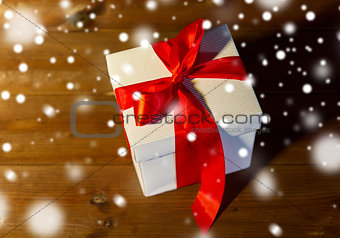 close up of christmas  gift box on wooden floor