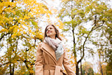beautiful happy young woman walking in autumn park