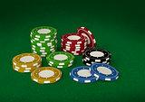 Casino chips 3D on green velvet