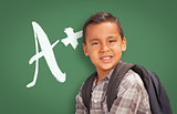 Hispanic Boy Up in Front of A+ Written on Chalk Board
