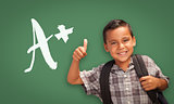 Hispanic Boy with Thumbs Up in Front of A+ Written on Chalk Boar