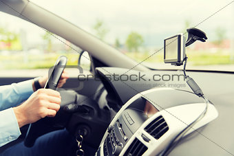 close up of man with gps navigator driving car