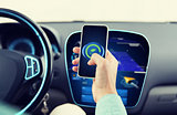 man driving car and setting eco mode on smartphone