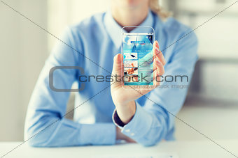 close up of woman with world news on smartphone