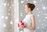 bride or woman in white dress with flower bunch