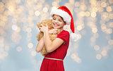 smiling girl in santa helper hat with teddy bear