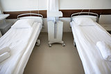 hospital ward with clean empty beds