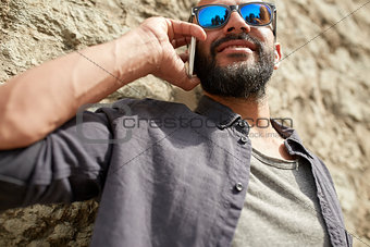 close up of man calling on smartphone in city