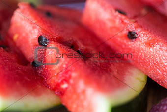 close up of watermelon slices on wooden table
