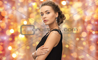 beautiful woman with gem stone earrings