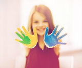 happy girl showing painted hands