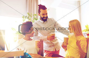 business team with coffee cups talking at office