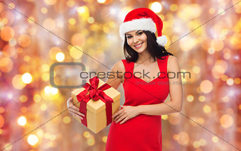 beautiful sexy woman in santa hat with gift box