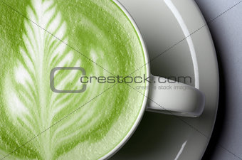 close up of matcha green tea latte in cup