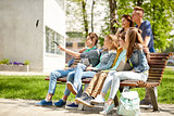 happy teenage students taking selfie by smartphone